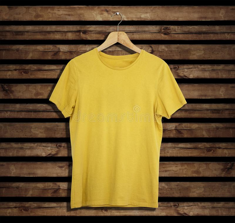 T-shirt mockup and template on wood background for fashion and graphic designer. T-shirt mockup for fashion designer royalty free stock photo