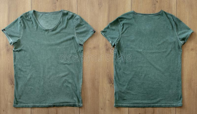 T-shirt mockup and template on wood background for fashion and graphic designer. T-shirt mockup for fashion designer stock photo