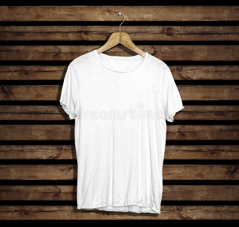 T-shirt mockup and template on wood background for fashion and graphic designer. T-shirt mockup for fashion designer royalty free stock photography