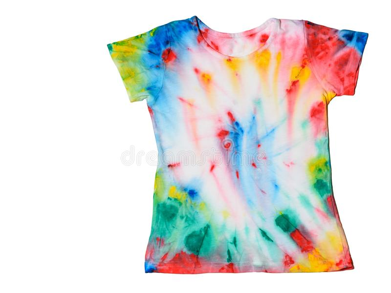 T-shirt painted in tie dye style isolated on a white background. FLat lay. The view from the top. Place for text. stock photo