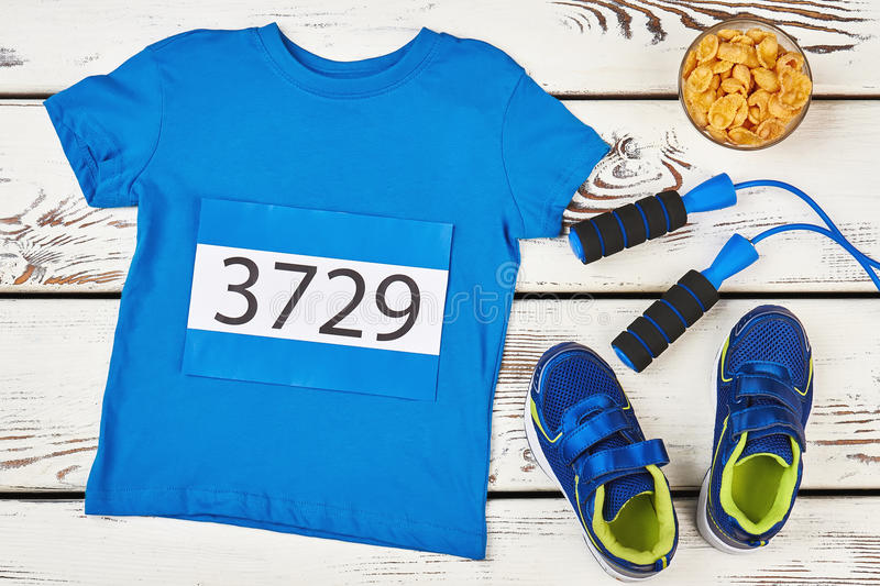 T-shirt, skipping rope and cornflakes. Run to your goal royalty free stock image