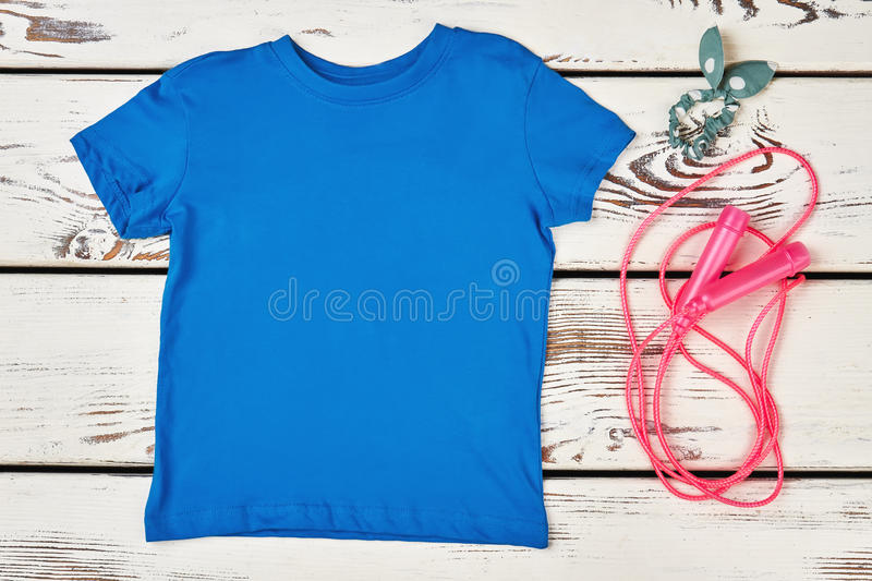 T-shirt, skipping rope and scrunchy. Sport and beauty royalty free stock photos
