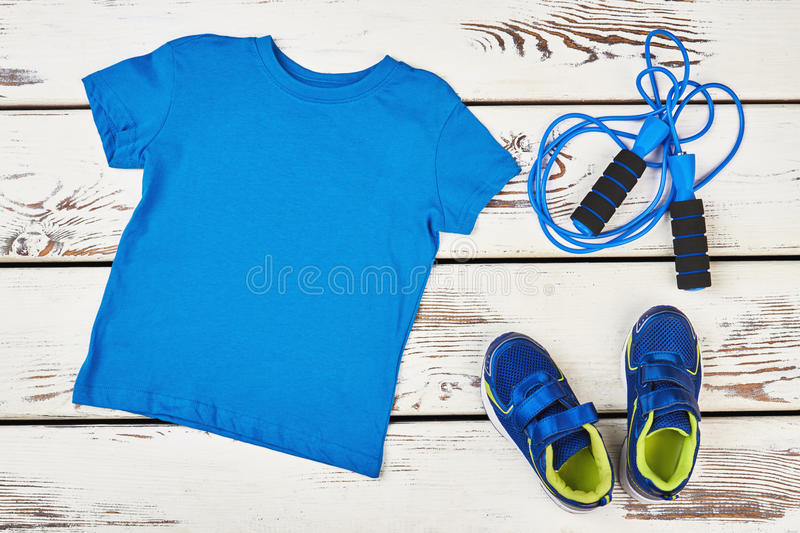 T-shirt, skipping rope and sneakers. Positive body transformation stock photos