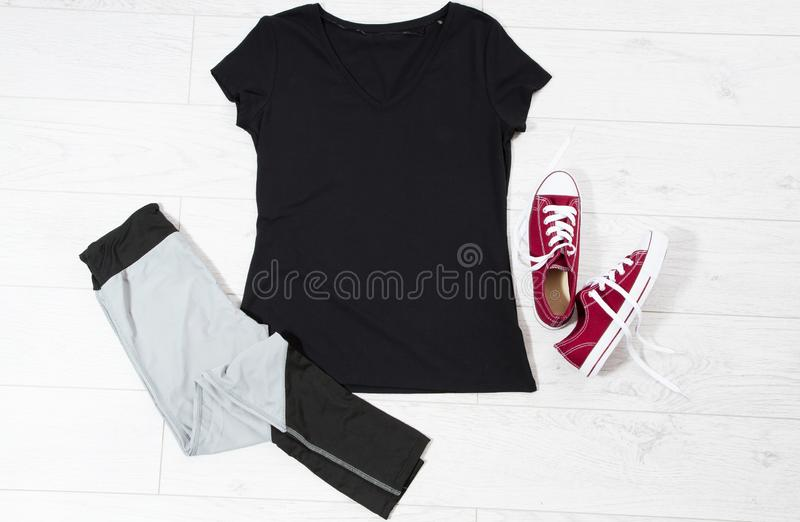 T-shirt top view, t shirt mock up, empty tshirt. Summer concept casual clothes background copy space. Blank shirt on wooden. Background stock images