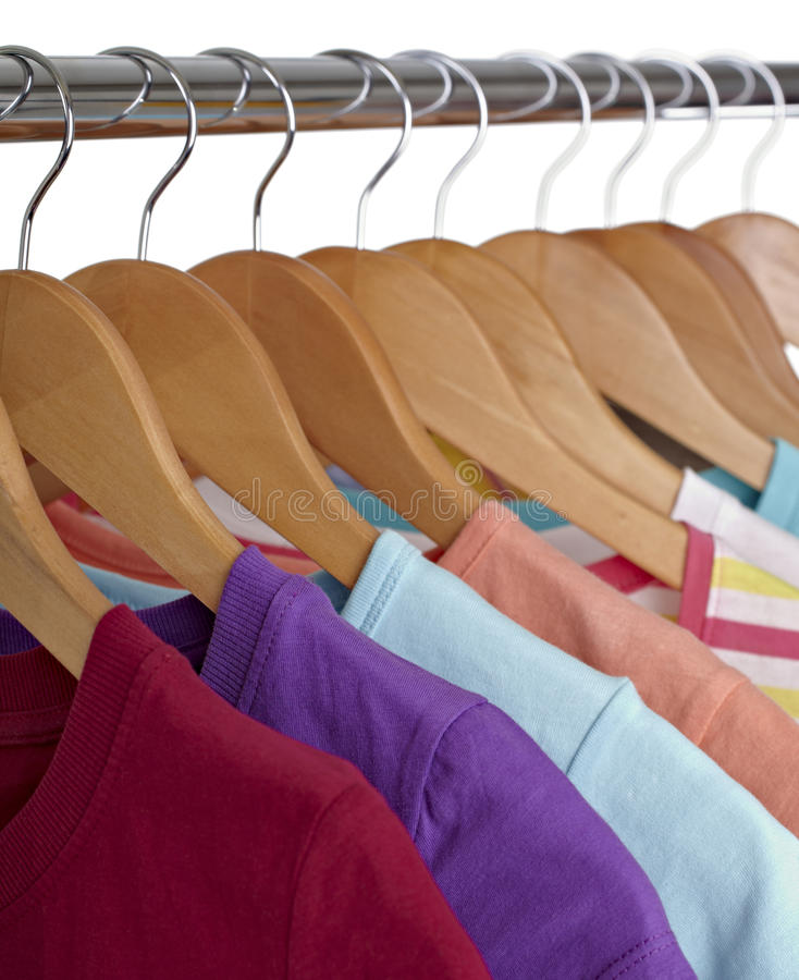 Download T shirts on cloth hangers stock photo. Image of shop - 18299858