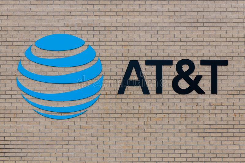 AT and T sign on brick wall stock photo