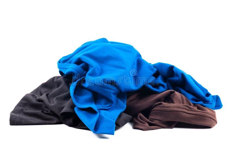 T-tröjakläderhög arkivbilder