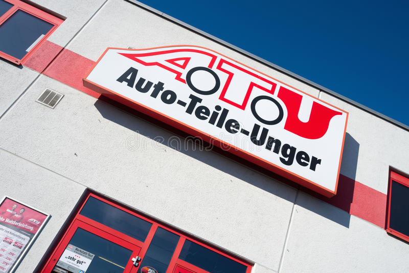 A.T.U sign at shop stock images