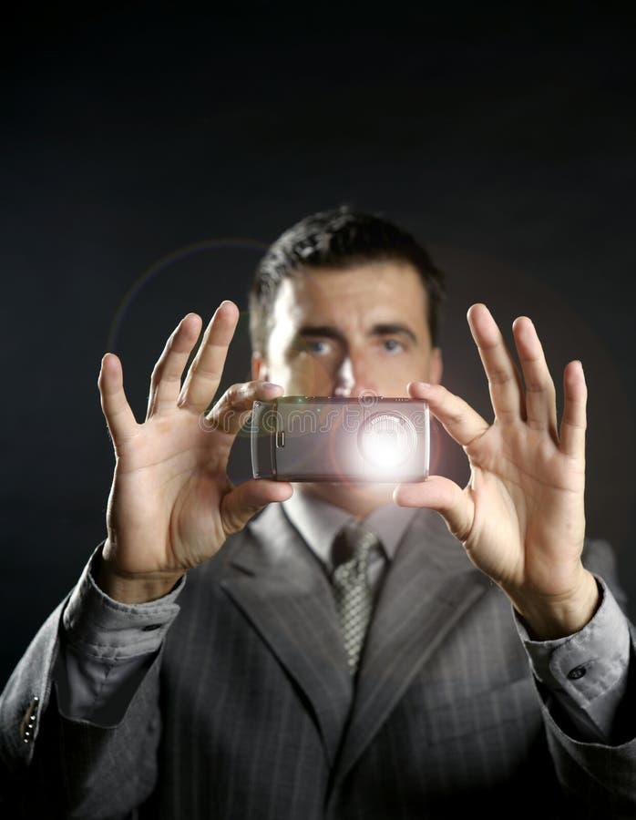 ta för foto för affärsmankamera mobilt arkivfoton