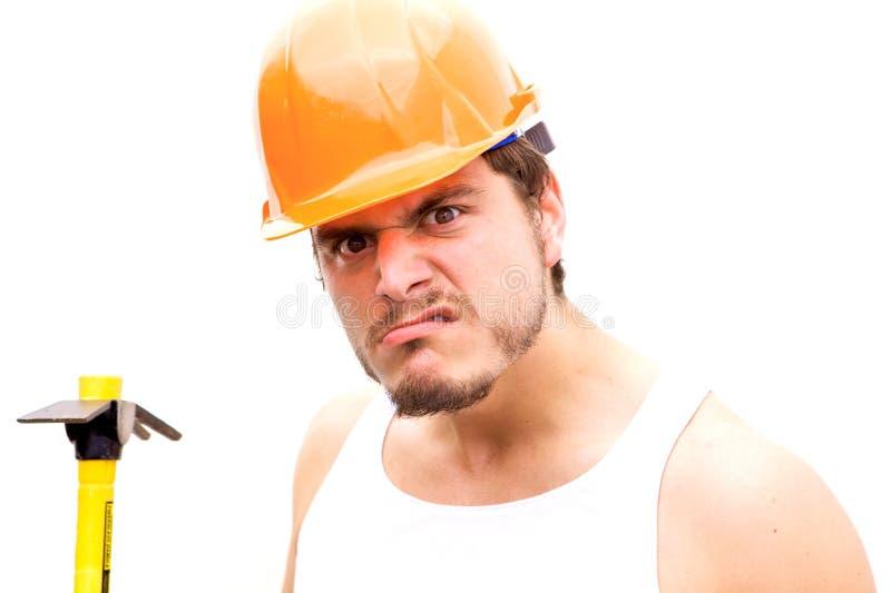 Taaie Kerel in een bouwvakker stock afbeelding