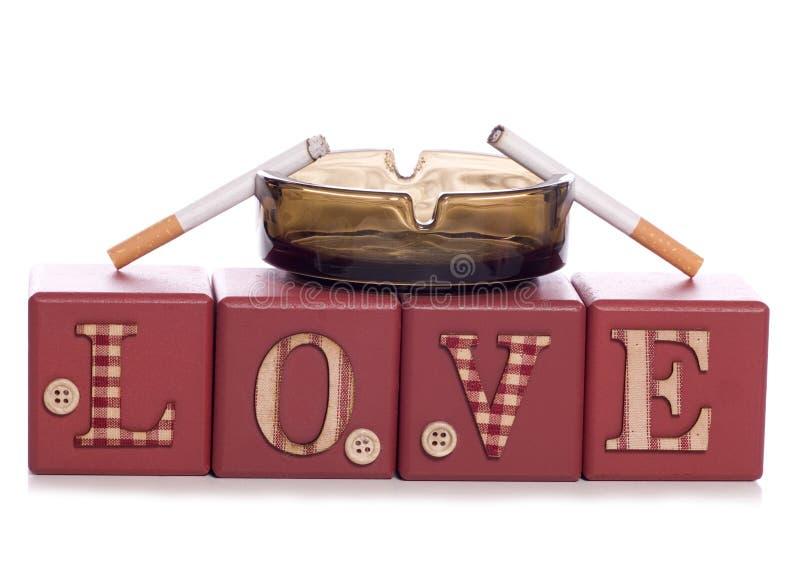 Tabagisme d'amour image libre de droits