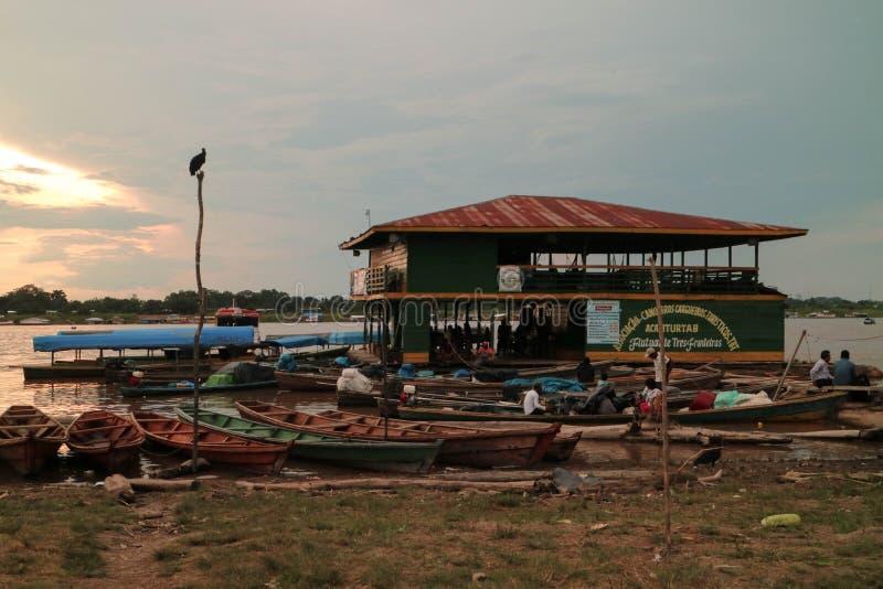 Wooden canoe in river port stock photo