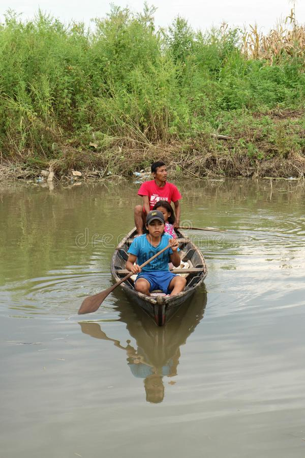 Wooden canoe in river port stock photography