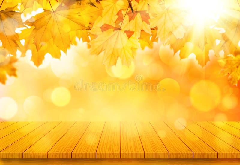 Tabela de madeira com as folhas de bordo alaranjadas da queda Fundo natural do outono fotografia de stock