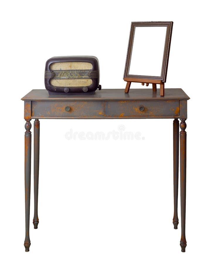 Tabela de madeira do vintage com as duas gavetas pintadas em cinzento e laranja, quadro marrom ornamentado de madeira da foto do  imagem de stock