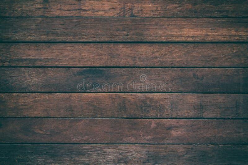 A tabela de madeira de superfície do vintage e a grão rústica texture o fundo