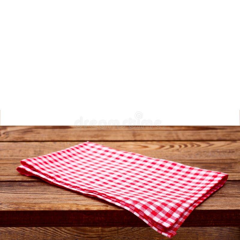 Tabela de madeira vazia da plataforma com toalha de mesa fotografia de stock