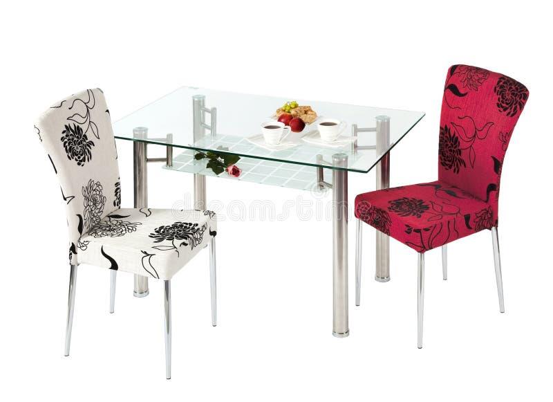 Tabela e cadeiras de vidro de jantar fotos de stock