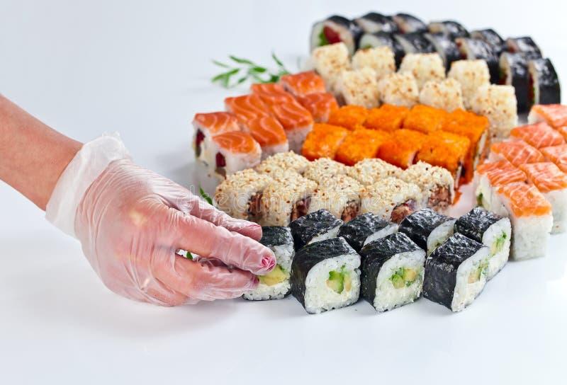 Tabell med sushi royaltyfri bild