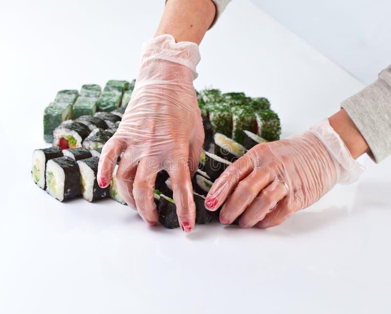 Tabell med sushi royaltyfria foton