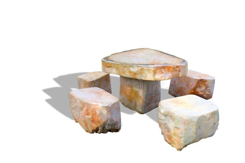 Tabelle gemacht vom Steinisolat auf einem weißen Hintergrund stockfotos