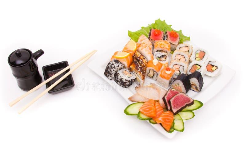 Tabelltidsbeställningar av sushi royaltyfria bilder