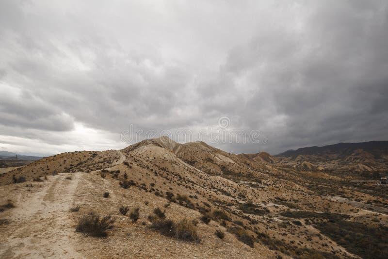Tabernas Desert - Almería, Spain. Tabernas Desert with clouds - Almería, Spain royalty free stock images