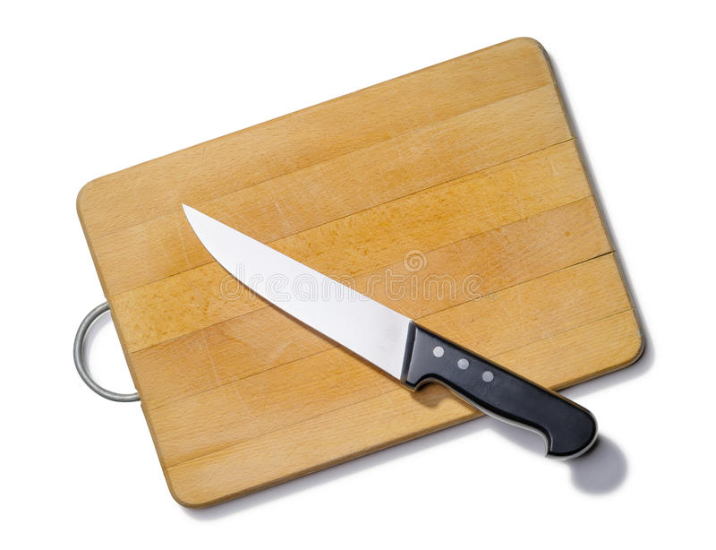 Tabla de cortar de madera con el cuchillo de cocina fotografía de archivo