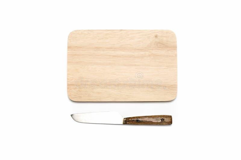 Tabla de cortar y cuchillo imagen de archivo libre de regalías