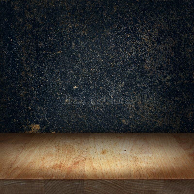Tabla de madera del top de la cocina con el punto ligero brillante y la piedra oscura b fotografía de archivo libre de regalías