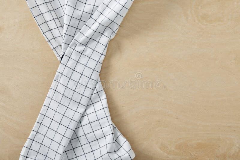 Tabla de madera de OM de la servilleta de la célula de la materia textil con el espacio de la copia imagen de archivo libre de regalías