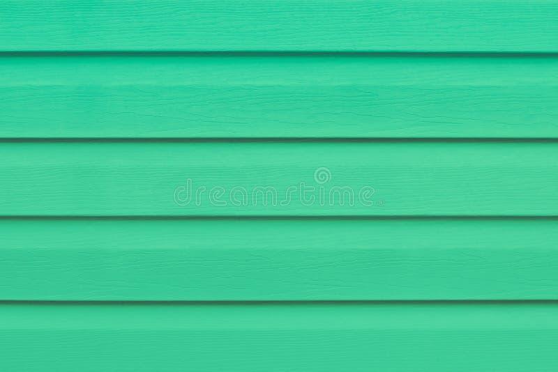 Tabla de madera verde en líneas El panel rayado, superficie, fondo Textura de los listones Tablón - madera La luz pintó a los tab imagen de archivo libre de regalías