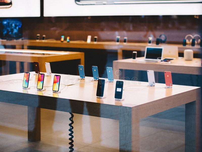 Table with all iPhone Xr smartphone by Apple Computers launch royalty free stock photos