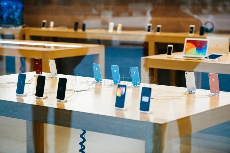 Table with all iPhone Xr smartphone by Apple Computers launch stock photography