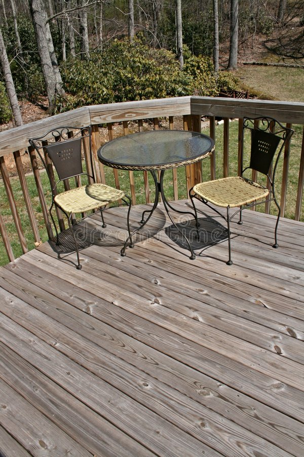 Free Table And Chairs On Wood Deck Royalty Free Stock Photography - 4695897