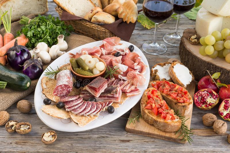 Table with assortment of Italian Foods. Various italian foods on a wooden table stock photography