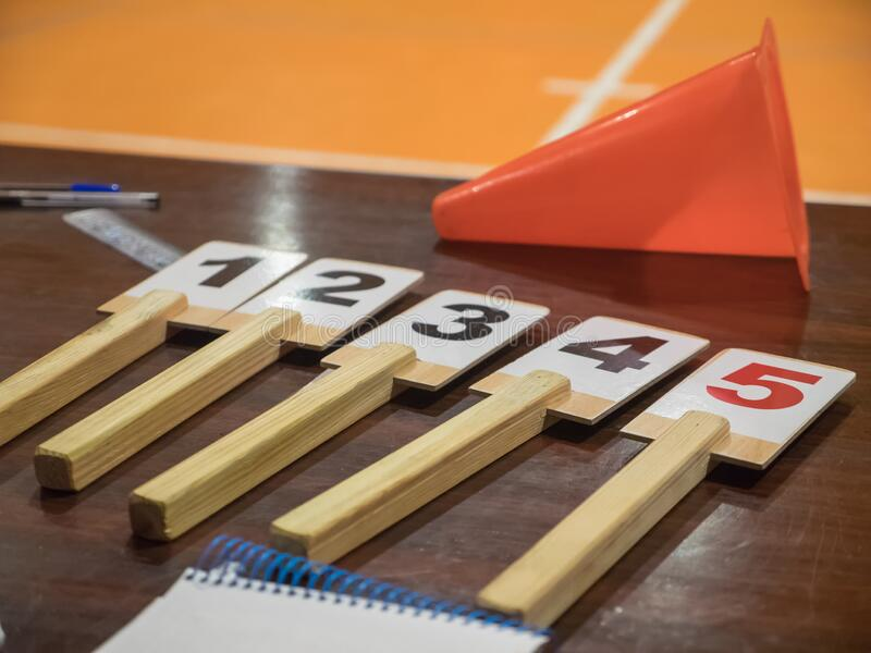 Table of a basketball game with the number of fouls, notebook, cone, scoreboard. Sport concept royalty free stock images
