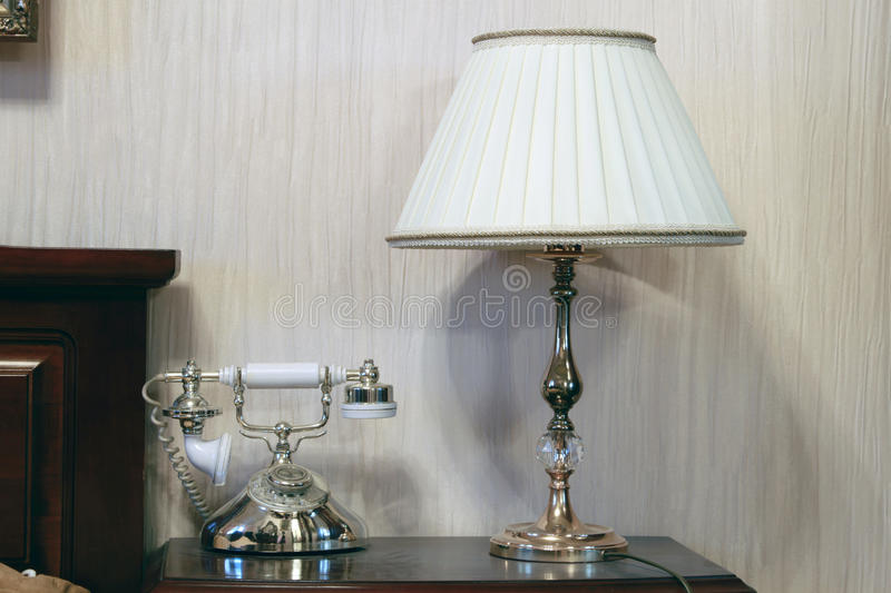 Table And Bedside Lamp With Telephone Stock Photos
