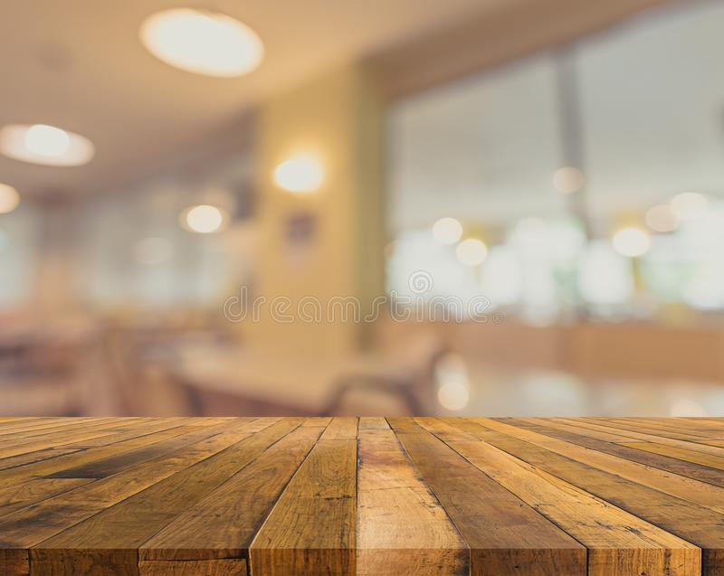 table and blur restaurant for background usage . royalty free stock photos