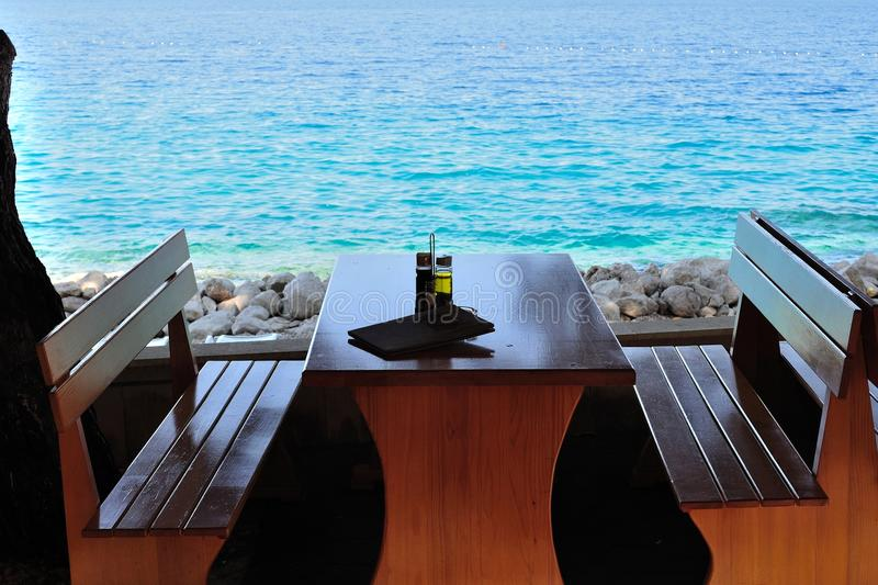 Table with bottles in restaurant on the beach stock photo
