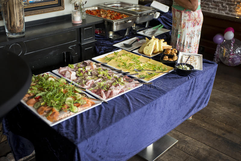 Table with Buffet. In a Grand Cafe Restaturant, in Naaldwijk, the Netherlands royalty free stock image