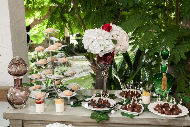 Table with cake, sweets and desserts for the reception of weddings and parties.  stock images