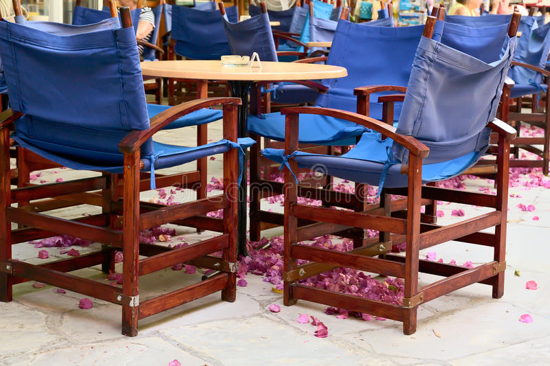 Table and chairs. Coffee table and chairs in arcade, Limassol, Cyprus stock photo
