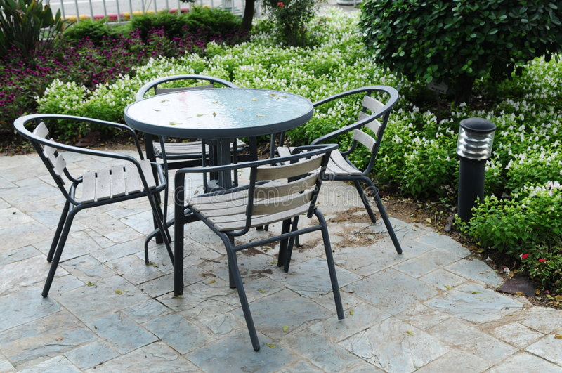 The table and chairs in patio stock images