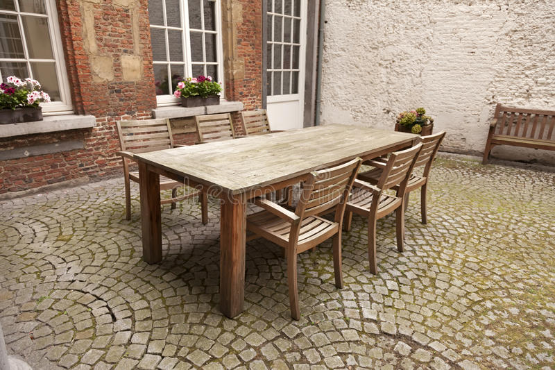 Table and chairs in patio royalty free stock photography