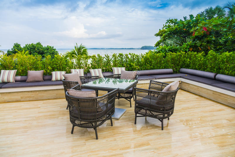Table and chairs at restaurant in tropical sea . stock photo