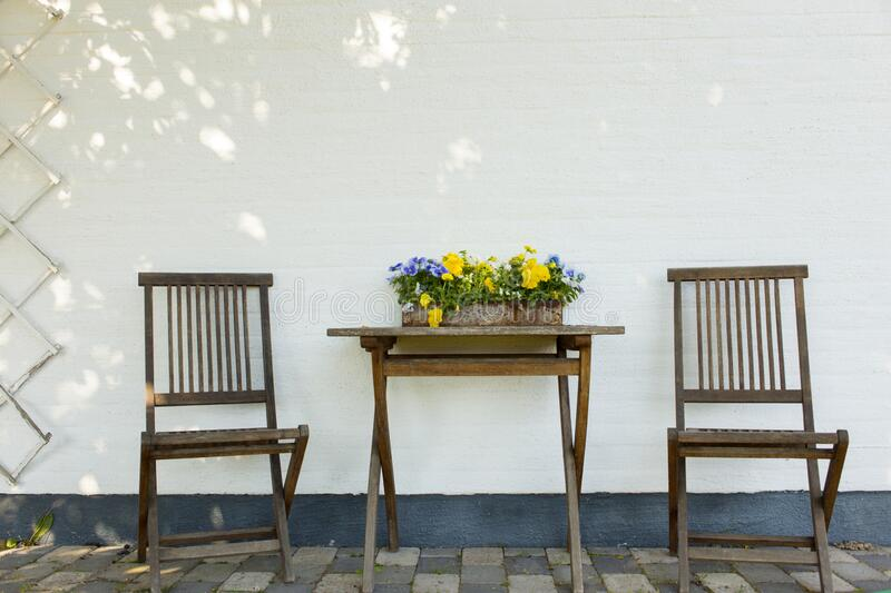 Table and chairs on a patio royalty free stock images