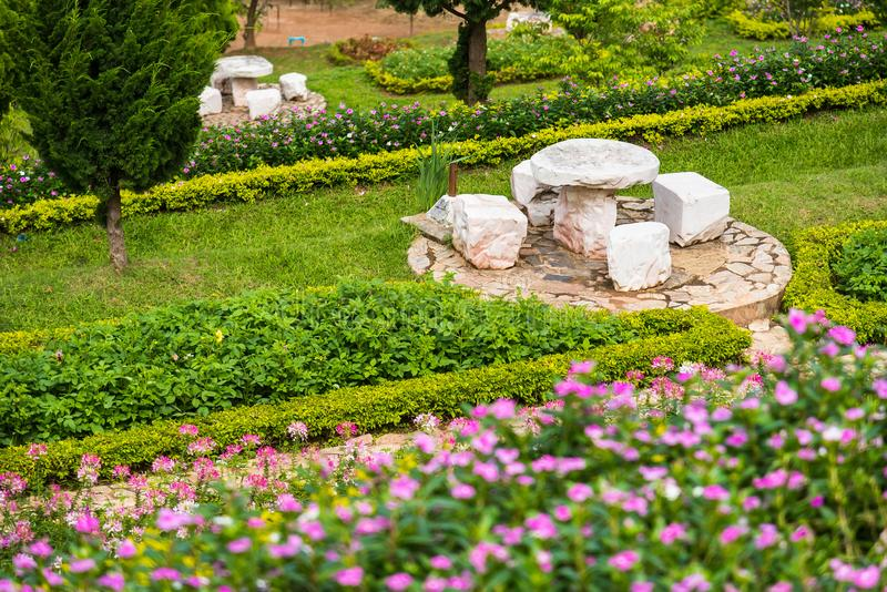 Table and chairs stone decorated garden in the park. Nature, beautiful, green, outdoor, natural, walk, background, walkway, footpath, road, pathway, pattern stock photography