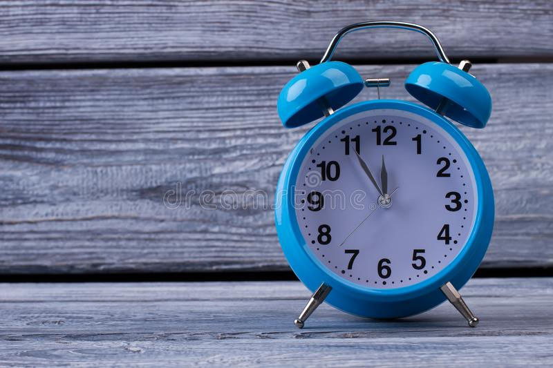 Table clock on wooden background stock photography
