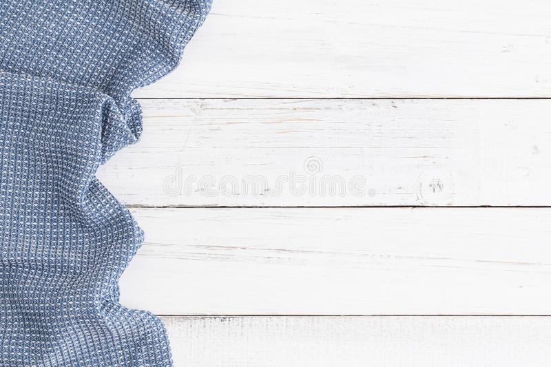 Table cloth blue on white table wood,top view and copy space for royalty free stock photography